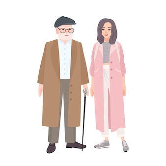 Happy grandfather and granddaughter dressed in stylish outerwear standing together.