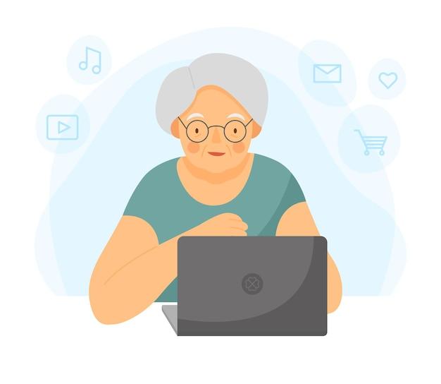 Счастливая бабушка с ноутбуком старушка работает на ноутбуке бабушка сидит за компьютером