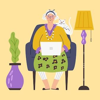 노트북에서 고양이와 함께 행복 한 할머니