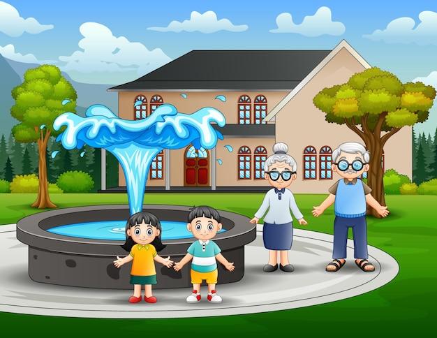 Счастливые бабушка и дедушка с внуками в парке
