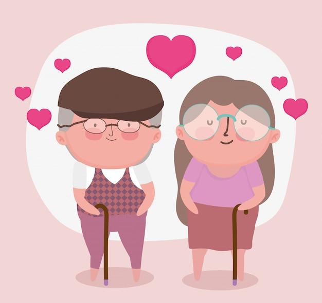 행복한 조부모의 날. 사랑에 산책 막대기로 귀여운 옛 커플