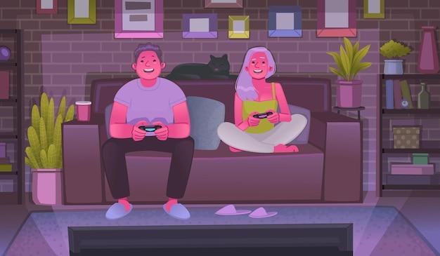 행복한 남자와 여자는 게임 콘솔에서 비디오 게임을 하며 저녁에 함께 즐거운 시간을 보낸다