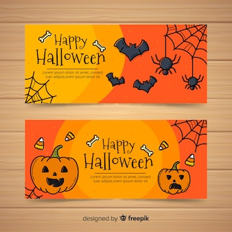 Happy halloween banner collection with spiders and pumpkins in hand drawn style