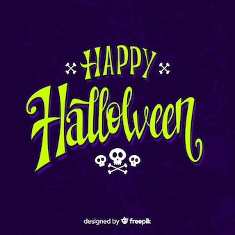 Happy halloween calligraphy with skulls