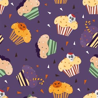 かわいいハロウィーンの要素の背景のシームレスなパターンでハッピーハロウィンカップケーキ