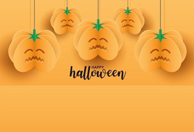 Счастливого хэллоуина. дизайн с тыквой висит на оранжевом фоне. бумажный художественный стиль.