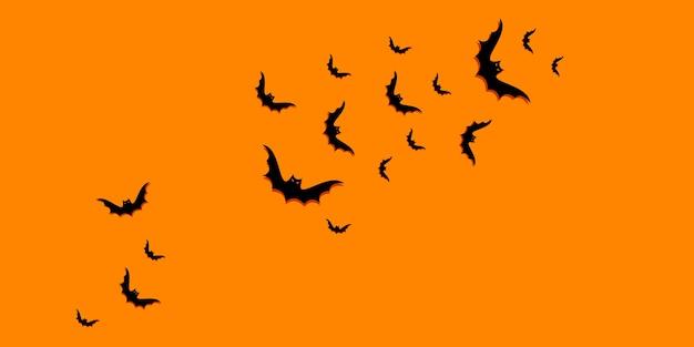 コピースペースと黒いコウモリと幸せなハロウィーンのグラデーションの背景。フラットレイ、上面図。最小限のコンセプト