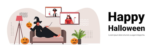 Happy halloween holiday celebration woman in witch costume discussing with friends during video call