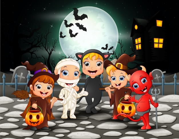 Happy halloween kids in full moon background