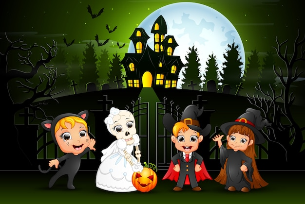 Happy halloween kids outdoors with haunted house background