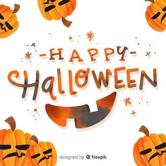 Happy halloween lettering with pumpkins