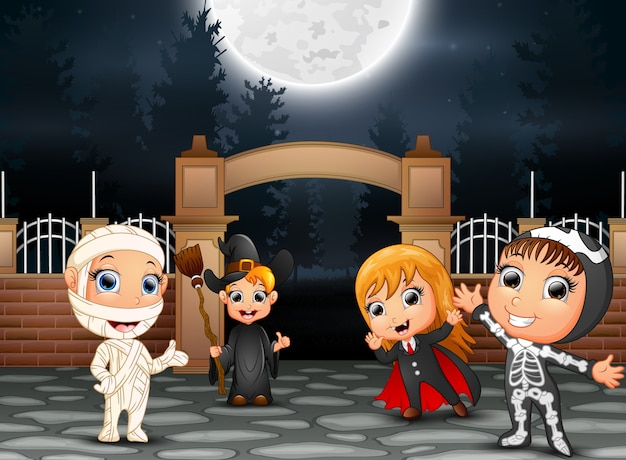 Happy halloween party with group of children in different costume