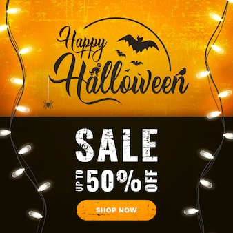 Happy halloween sale promotion banner with bright garland lights on dark and orange
