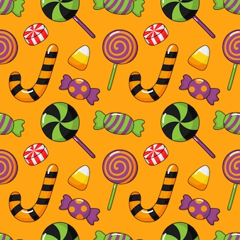 Happy halloween seamless pattern and cartoon candies isolated on orange
