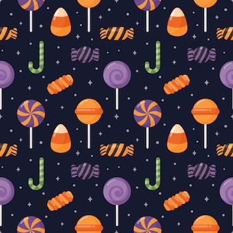 Happy halloween seamless pattern and cartoon candies isolated on purple