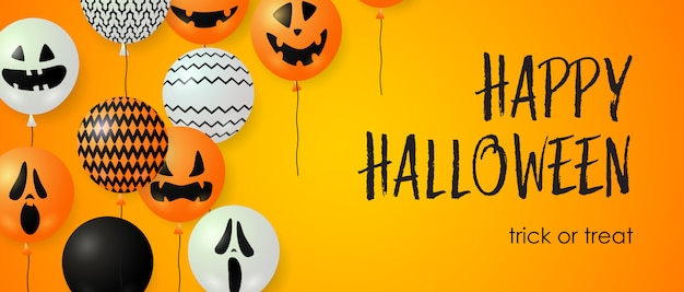 Happy halloween, trick or treat lettering and balloons