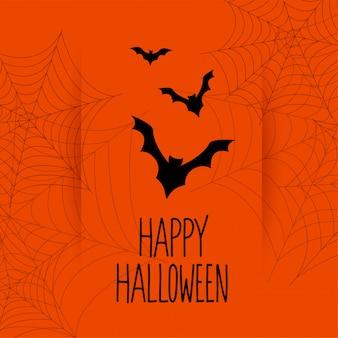 Happy halloween with bats and spiderwebs