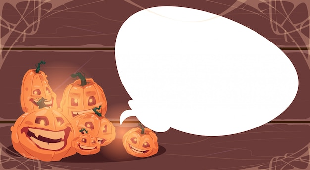 Happy halloween with different pumpkins over white chat bubble. traditional decoration greeting card