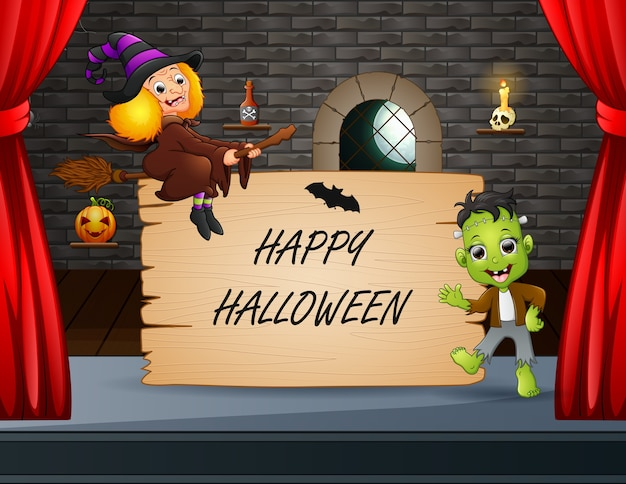 Happy halloween with frankenstein and witch performing on stage