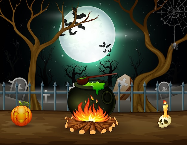 Happy halloween with a potion in a cauldron in front a graveyard