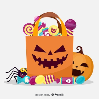 Happy halloween with sweets in a paper bag