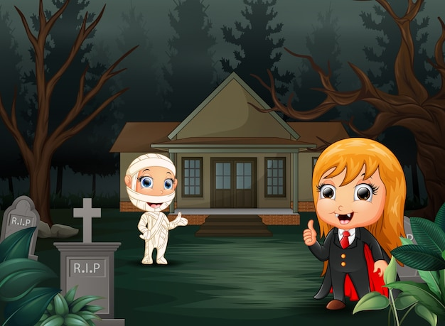 Happy halloween with vampire and mummy cartoon