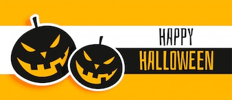 Happy halloween yellow banner with laughing pumpkins