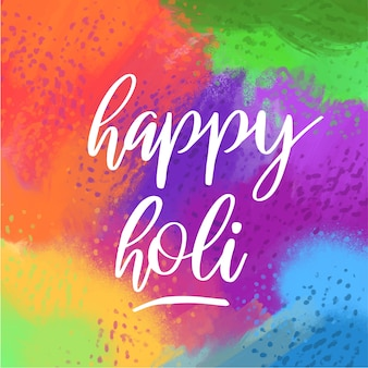 Happy holi lettering with colourful background