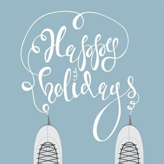 Ледовые коньки и рукописный текст happy holidays.