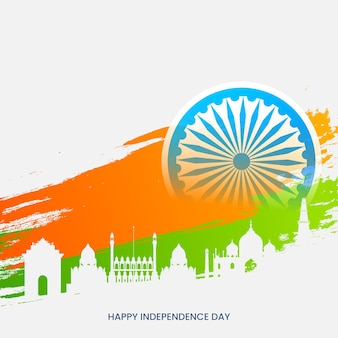 Happy independence day concept with ashoka wheel, saffron and green brush effect on white silhouette famous monument background.