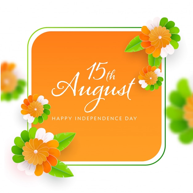 Happy independence day font on saffron and white background decorated with paper flowers.