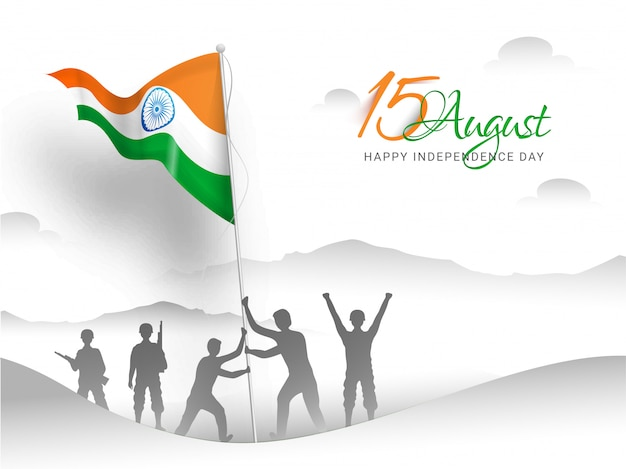 Happy indian independence day. indian army soldier doing flag hoisting on top of mountain
