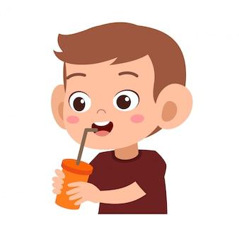 Happy kid drinks juice