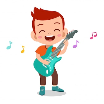 Happy kid play electric guitar music