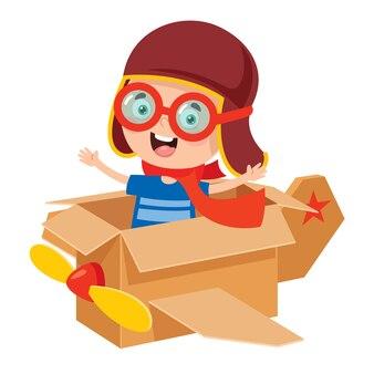 Счастливый малыш играет с картонными костюмами
