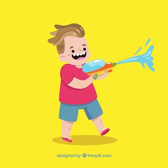 Happy kid playing with water gun
