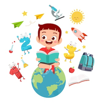Happy kid reads books on the world globe