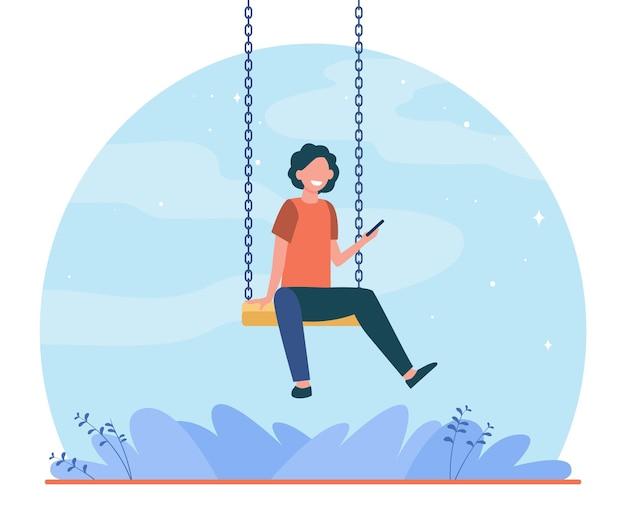 Счастливый ребенок сидит на качелях и держит телефон. мальчик, смартфон, игровая плоская иллюстрация