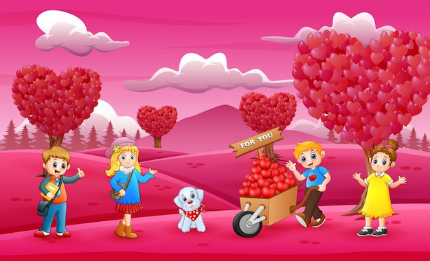 Happy kids celebrating a valentine day on the pink garden