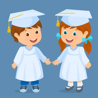 Happy kids graduated. couple of children with caps
