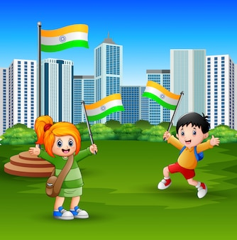 Happy kids holding national flag on the city park