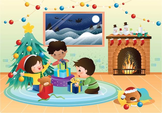 幸せな子供たちがクリスマスプレゼントを開く