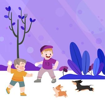 幸せな子供たちは犬と一緒に庭で遊ぶ