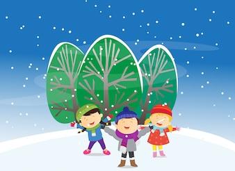 Happy kids playing outdoors in winter season