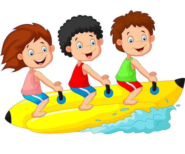 Happy kids riding a banana boat