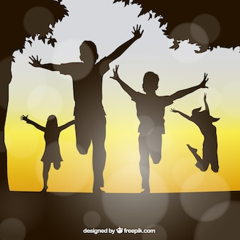 Happy kids silhouttes Free Vector