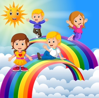 Happy kids standing over the rainbow