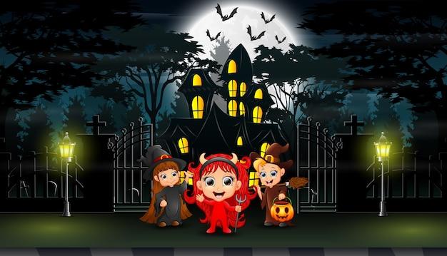 Happy kids wearing halloween costume outdoors