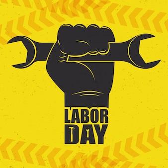 손과 렌치로 행복한 노동절 축하
