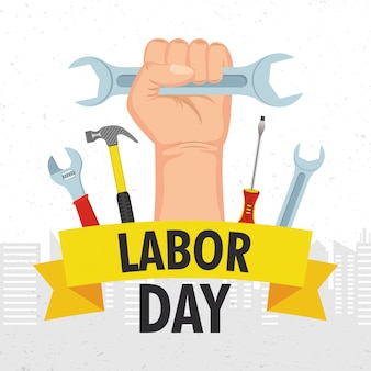 Happy labor day celebration with hand and wrench